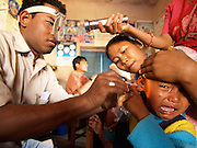Nepal, Nr. Nepalgunj. Nepalgunj Medical College Teaching Hospital.Specialist ear disease medical workers at a community health centre examine ears and assess ear health. They are trained by British medical charity BRINOS (British Nepal Otology Service) Photography by Richard Olivier&copy;2005<br />