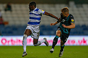 Queens Park Rangers midfielder Bright Osayi-Samuel (20) battles for possession with Swansea City defender Jake Bidwell (24) during the EFL Sky Bet Championship match between Queens Park Rangers and Swansea City at the Kiyan Prince Foundation Stadium, London, England on 21 August 2019.