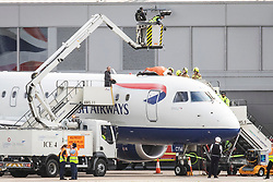 © Licensed to London News Pictures. 10/10/2019. London, UK. Emergency services use a cherry picker to try to remove an Extinction Rebellion protester on top of a British Airways plane at London City Airport. Protesters planned to occupy the terminal building in a 'Hong Kong-style' shutdown as part of ongoing protests calling on government departments to tackle the Climate Emergency. Photo credit: Rob Pinney/LNP