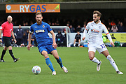 AFC Wimbledon midfielder Scott Wagstaff (7) taking on Luton Town midfielder Andrew Shinnie (11) during the EFL Sky Bet League 1 match between AFC Wimbledon and Luton Town at the Cherry Red Records Stadium, Kingston, England on 27 October 2018.