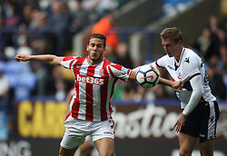 Ramadan Sobhi of Stoke City (L) Stephen Darby of Bolton Wanderers in action - Mandatory by-line: Jack Phillips/JMP - 29/07/2017 - FOOTBALL - Macron Stadium - Bolton, England - Bolton Wanderers v Stoke City - Pre-Season Club Friendly