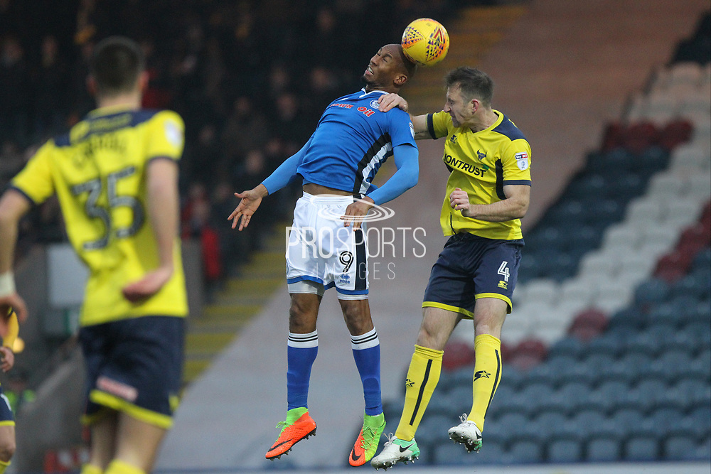 Calvin Andrew wins a header during the EFL Sky Bet League 1 match between Rochdale and Oxford United at Spotland, Rochdale, England on 16 December 2017. Photo by Daniel Youngs.