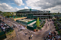 Spectators are let into the grounds at the start of day two of the Wimbledon Championships at The All England Lawn Tennis and Croquet Club, Wimbledon.