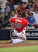 ATLANTA, GA - JUNE 08:  Left fielder Jason Heyward #22 of the Atlanta Braves slides into home plate for the winning run during the game against the Toronto Blue Jays at Turner Field on June 8, 2012 in Atlanta, Georgia.  (Photo by Mike Zarrilli/Getty Images)
