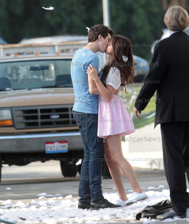 August 10th 2012 Sherman Oaks, CA. Non-Exclusive<br /> Selena Gomez kisses actor Nat Wolff while filming a scene for 'Parental Guidance'. Selena and Nat appeared to have great chemistry together both on and off camera. The two young actors spent all afternoon filming their kissing scene over and over from various angles, wide shots and close-ups. There was plenty of laughing, joking and flirtatious behavior between Selena and Nat in between takes as well. The two were seen holding hands even after the cameras had stopped rolling. They also kept sharing a pair of earphones to listen to music together. Actor Cary Elwes was also in the scene which somehow involved a truck full of chickens and their feathers going everywhere. <br /> Photo by Eric Ford/ On Location News 1/818-613-3955 info@onlocationnews.com