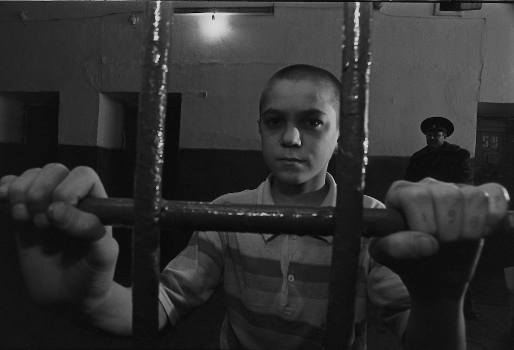 A suspect boy holds a cell at deporting to children's colony in the oldest Siberian prison in Mariinsk, Russia, 05 February 1996.