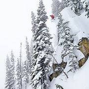 Jim Ryan launches a major cliff under the Sublette chair inbounds at JHMR.