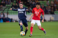 MELBOURNE, AUSTRALIA - APRIL 23: Joshua Hope (16) of Melbourne Victory is challenged by He Chao (13) of Guangzhou Evergrande during the AFC Champions League Group Stage match between Melbourne Victory and Guangzhou Evergrande at AAMI Park on April 23, 2019 in Melbourne, Australia. (Photo by Speed Media/Icon Sportswire)