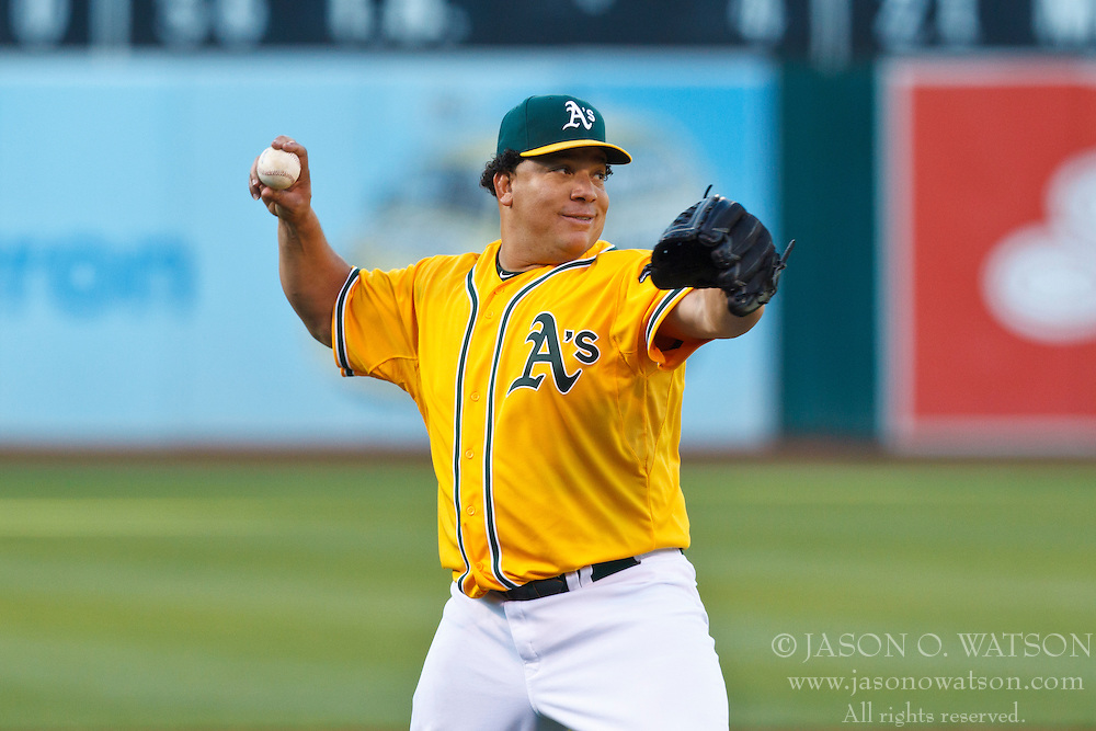 OAKLAND, CA - JULY 17: Bartolo Colon #21 of the Oakland Athletics throws to first base after fielding a ground ball against the Texas Rangers during the first inning at O.co Coliseum on July 17, 2012 in Oakland, California. The Texas Rangers defeated the Oakland Athletics 6-1. (Photo by Jason O. Watson/Getty Images) *** Local Caption *** Bartolo Colon