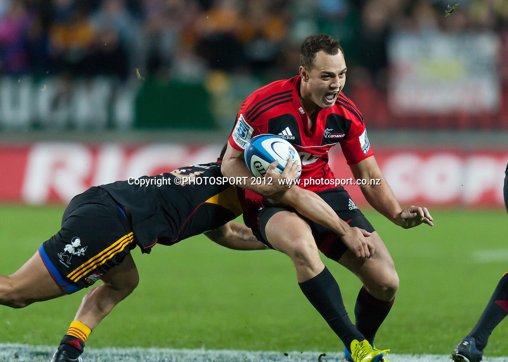 Crusaders' Israel Dagg tackled by Chiefs' Tim Nanai-Williams during the Super Rugby Semi Final won by the Chiefs (20-17) against the Crusaders at Waikato Stadium, Hamilton, New Zealand, Friday 27 July 2012. Photo: Stephen Barker/Photosport.co.nz