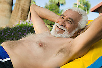 Senior Man Lying on Lawn Chair