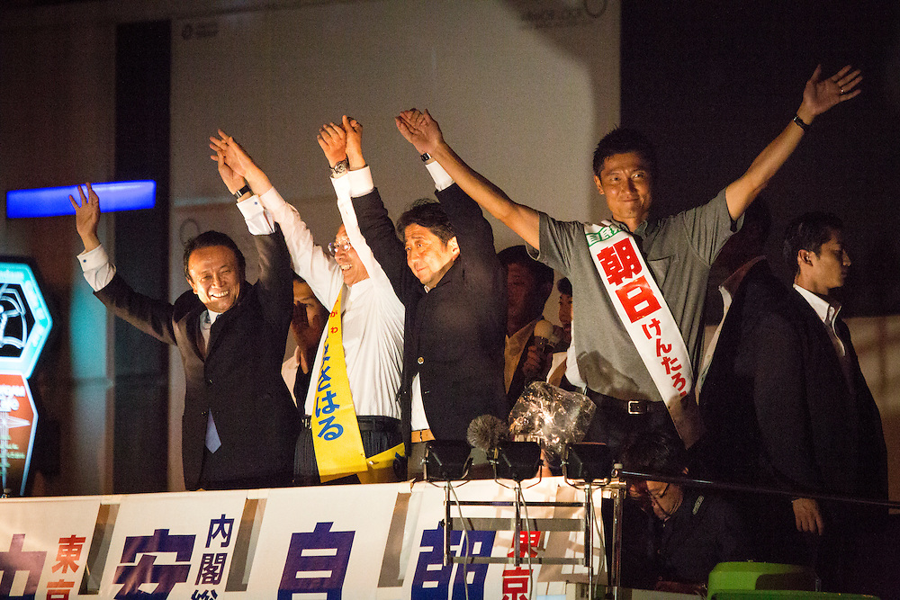 TOKYO, JAPAN - JULY 9 :  Japanese Prime Minister Shinzo Abe, president of the ruling Liberal Democratic Party (LDP) and Tarō Asō, attended the campaign speech to support candidate Masaharu Nakagawa and candidate Kentaro Asahi during the last day of the Upper House election campaign outside of Akihabara Station in Tokyo, Japan on July 9, 2016. Tomorrow, July 10, 2016 will be the first Upper house election nation-wide in Japan that 18 years old can vote after government law changes its voting age from 20 years old to 18 years old. (Photo by Richard Atrero de Guzman/NURPhoto)