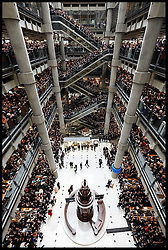 HM The Queen is escorted around the Lloyds of London building in the City of London, by The Chairman of Lloyds of London John Nelson, Thursday, 27th March 2014. Picture by  i-Images