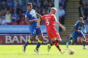 AFC Wimbledon striker Lyle Taylor (33)  looks to tackle Walsall FC defender Jason McCarthy (5) during the EFL Sky Bet League 1 match between Walsall and AFC Wimbledon at the Banks's Stadium, Walsall, England on 6 August 2016. Photo by Stuart Butcher.