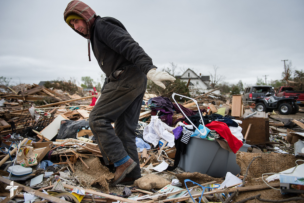Glenn Bueber sifts through debris in a neighborhood on Monday, May 11, 2015, in Delmont, S.D. A tornado swept through the area the previous day and destroyed Zion Lutheran Church and nearby buildings. LCMS Communications/Erik M. Lunsford