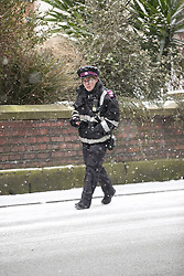 """© Licensed to London News Pictures. 01/03/2018. Manchester, UK. A traffic warden continues to work despite snowfall and ice in Manchester , as the weather pattern referred to as """" The Beast from the East """" gives way to Storm Emma , causing sub-freezing temperatures and widespread disruption across the UK . Photo credit: Joel Goodman/LNP"""
