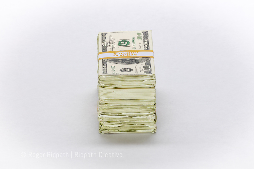 Stack of American $100 bills paper money short side horizontal