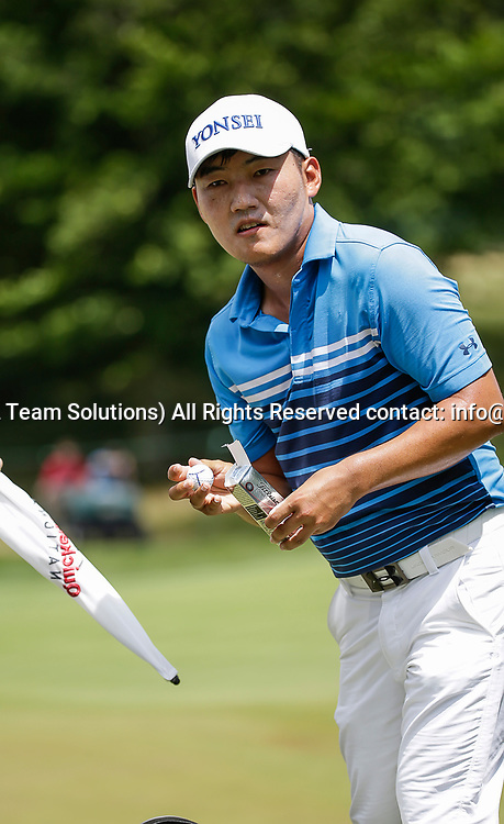 POTOMAC, MD - JULY 01:  Sung Kang gets another ball from his bag before heading to the 7th tee box during the third round of the Quicken Loans National at TPC Potomac at Avenel Farm in Potomac, MD.(Photo by Justin Cooper/Icon Sportswire)