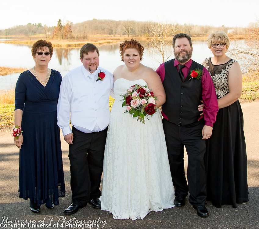 Bride and groom with their parents as a beautiful November wedding.