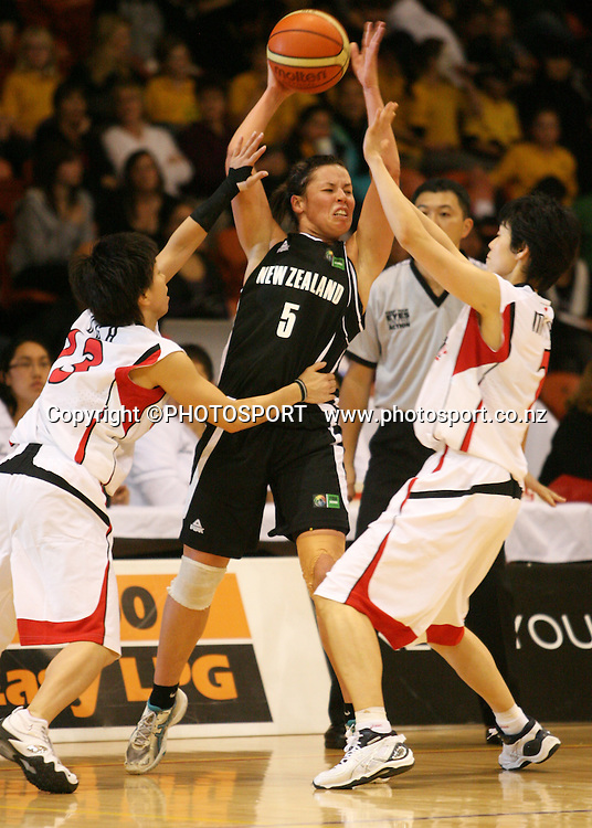 New Zealand's Zoe Kensington is surrounded by the defence. International basketball, Tall Ferns v Japan, PG Arena, Napier, Thursday 27 August 2009. Photo: John Cowpland/PHOTOSPORT