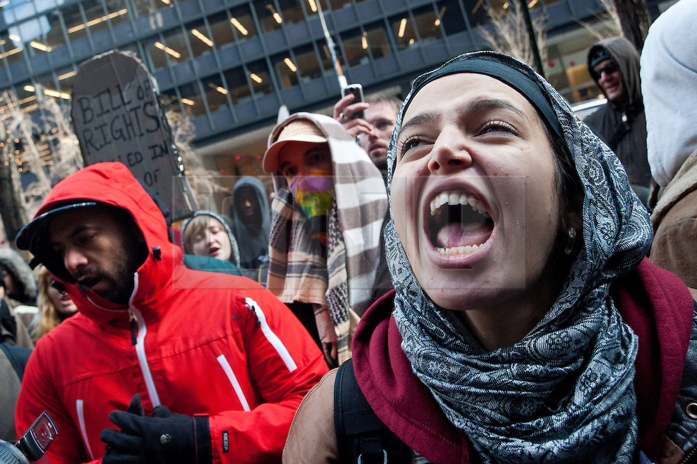© licensed to London News Pictures. New York City, New York, USA. 3/01/12. Demonstrators chant outside the officer of Charles Schumer, senior New York Senator, who voted in favour of the NDAA laws. Protests take place in manhattan against the recently passed National Defence Authorisation Act (NDAA), which protesters are concerned introduced indefinite detention powers to be used against those suspected of terrorism. Photo credit: Jules Mattsson/LNP