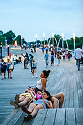 "WASHINGTON DC - June, 8: Sisters Elizabeth Drelichman, 15, foreground, and Maggie Drelichman, 18, middle right, from DC, host their cousins from Michigan Sophia Little, middle left, 19, and Isabella Little, 20, seen sitting up, at the District Wharf in the Southwest Waterfront neighborhood of Washington DC Friday, June 8, 2018. <br /> <br /> The Wharf is DC's latest attempt to be a ""real"" city. It took multiple agencies and act of congress to get it built. Did they repeat the mistakes of urban renewal (which moved lower income people out of the neighborhood)? Yes and no. People will still be driven out, but this time around the neighborhood is integrated more.<br /> (Photo by Matt Roth for The Washington Post)"
