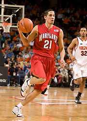 Maryland guard Greivis Vasquez (21) dribbles up court against UVA.  The Virginia Cavaliers defeated the Maryland Terrapins 91-76 at the University of Virginia's John Paul Jones Arena  in Charlottesville, VA on March 9, 2008.