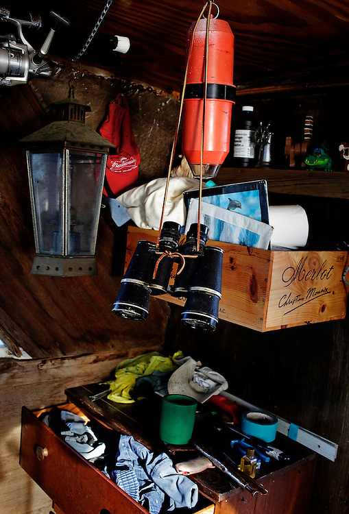Binoculars hang in Randy Eibler's houseboat anchored in Estero Bay, Fla. Eibler, 55, said he uses the binoculars to see everything from unique wildlife to approaching police boats.
