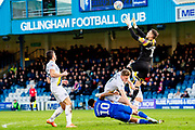 Gillingham FC forward Jordan Roberts (10), Oxford United defender Rob Dickie (4) and Oxford United goalkeeper Simon Eastwood (1) during the EFL Sky Bet League 1 match between Gillingham and Oxford United at the MEMS Priestfield Stadium, Gillingham, England on 18 January 2020.