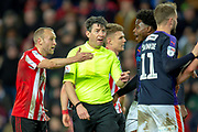 Dylan McGeouch (#8) of Sunderland AFC appeals to referee Lee Probert after he awards a penalty to Luton Town during the EFL Sky Bet League 1 match between Sunderland AFC and Luton Town at the Stadium Of Light, Sunderland, England on 12 January 2019.