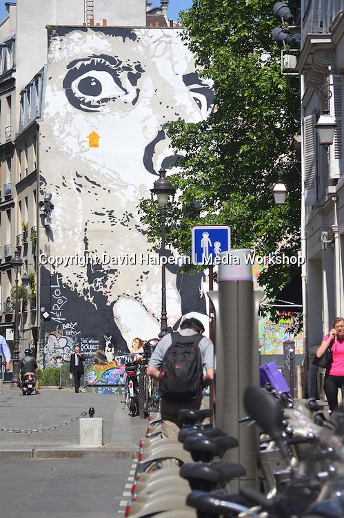 Big Face mural & municipal bikes