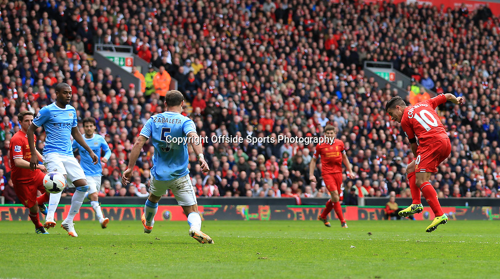 13th April 2014 - Barclays Premier League - Liverpool v Manchester City - Philippe Coutinho of Liverpool scores their 3rd goal - Photo: Simon Stacpoole / Offside.