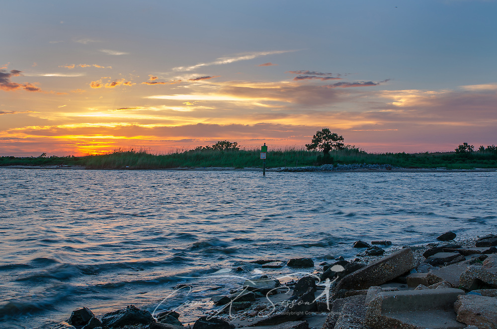 The sun sets in Bayou La Batre, Alabama at the Bayou La Batre State Docks on June 17, 2013. (Photo by Carmen K Sisson/Cloudybright)