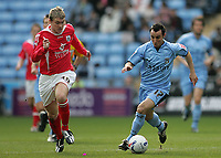 Photo: Lee Earle.<br /> Coventry City v Barnsley. Coca Cola Championship. 17/03/2007.Coventry's Michael Mifsud (R) sprints away from Grant McCann.