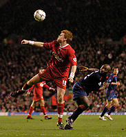 Photo. Jed Wee.Digitalsport<br /> Liverpool v Portsmouth, FA Barclaycard Premiership, Anfield, Liverpool. 17/03/2004.<br /> Liverpool's John Arne Riise (L) wins an aerial ball against Portsmouth's Lomana Lua Lua.