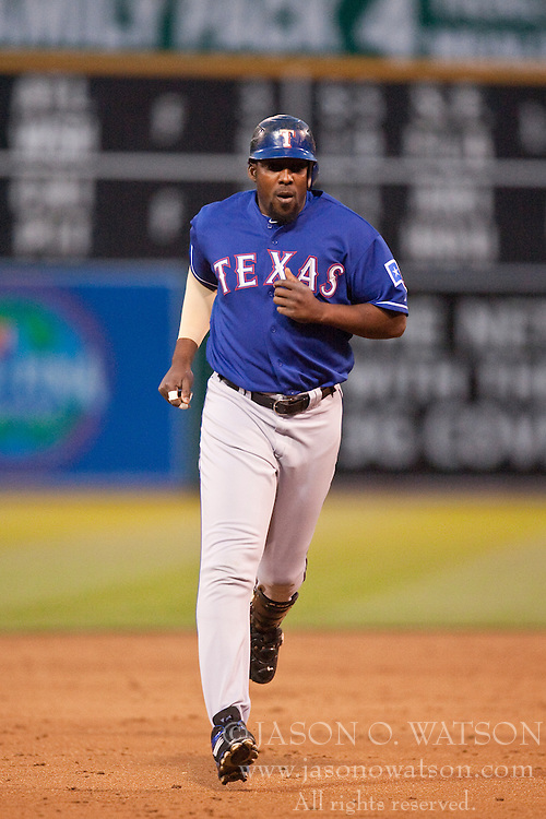May 4, 2010; Oakland, CA, USA;  Texas Rangers designated hitter Vladimir Guerrero (27) rounds the bases after hitting a grand slam off of Oakland Athletics starting pitcher Vin Mazzaro (not pictured) during the third inning at Oakland-Alameda County Coliseum. Oakland defeated Texas 7-6.