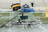 West Point, New York - A member of the West Point Parachute Team lands on the football field at Michie Stadium before the West Point Half-Marathon Fallen Comrades Run at the United States Military Academy on March 29, 2015.