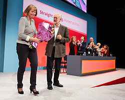 © Licensed to London News Pictures . 27/09/2015 . Brighton , UK . HARRIET HARMAN is presented with flowers by Labour Party Leader JEREMY CORBYN following a tribute to her record as Deputy Leader of the Labour Party , at the 2015 Labour Party Conference . Photo credit : Joel Goodman/LNP