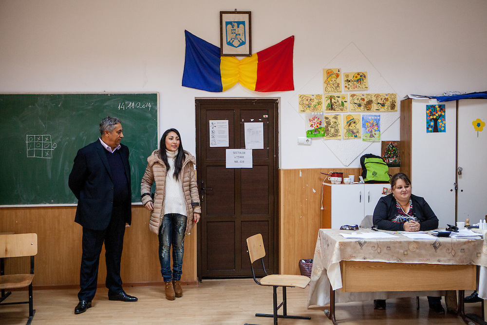 Gheorghe Tudor with his daughter Rodica-Elena Tudor at one of the two polling stations for the presidential elections in Marginenii de Jos.
