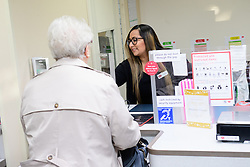 Pictured is Davina Singadia serving a customer<br /> <br /> Gill Furniss, MP for Brightside and Hillsborough, visited Margetson Crescent Post Office, Sheffield to meet subpostmistress Angelina Singadia and her team.<br /> <br /> Date: December 8, 2017