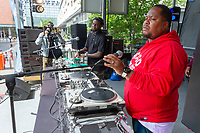 The 5th annual Hyde Park Brew Fest was held Saturday and Sunday, June 5th and 6th, 2018. Participants were treated to a day of music and beer tastings from local breweries with a headline performance by the legendary D.J. Jazzy Jeff. The event was sponsored by the Kimbark Beverage Shoppe, the Hyde Park Chamber of Commerce, Courvosoier and Effen.<br /> <br /> 0130 &ndash; Curator of the musical experience, Dave Jeff hangs out on stage.<br /> <br /> Please 'Like' &quot;Spencer Bibbs Photography&quot; on Facebook.<br /> <br /> Please leave a review for Spencer Bibbs Photography on Yelp.<br /> <br /> Please check me out on Twitter under Spencer Bibbs Photography.<br /> <br /> All rights to this photo are owned by Spencer Bibbs of Spencer Bibbs Photography and may only be used in any way shape or form, whole or in part with written permission by the owner of the photo, Spencer Bibbs.<br /> <br /> For all of your photography needs, please contact Spencer Bibbs at 773-895-4744. I can also be reached in the following ways:<br /> <br /> Website &ndash; www.spbdigitalconcepts.photoshelter.com<br /> <br /> Text - Text &ldquo;Spencer Bibbs&rdquo; to 72727<br /> <br /> Email &ndash; spencerbibbsphotography@yahoo.com<br /> <br /> #killyourcity #citykillerz #illgramers #way2ill #agameoftones #urbex #createexplore #exploretocreate #streetactivityteam #streetdreamsmag #neverstopexploring #featuremeinstagood #igersone #shoot2kill #streetshared #streetmobs #urbanphotography #streetphotography #streetexploration #urbanandstreet #imaginatones #streettogether #streetmagazine #streetmobs #peopleinsquare #moodygrams #illgrammers #instamagazine #twgrammers #shotaroundmag #illkillers #killergrams #superhubs #urbanromantix #livefolk #shotaward #_heater #yngkillers #shotzdelight #1stinstinct  #heatercentral <br /> #agameoftones #ig_masterpiece #ig_exquisite #ig_shotz #global_hotshotz #superhubs #main_vision #master_shots #exclusive_shots #hubs_united #jaw_dropping_shotz #worldshotz #theworldshotz #pixel_ig #photographyislifee #photographyislife #photographysouls #photographyeveryday #photographylover #worldbestgram #iglobal_photographers #ig_grea