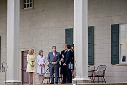 U.S. First Lady Melania Trump, from right, Emmanuel Macron, France's president, U.S. President Donald Trump, Doug Bradburn, president and chief executive officer of George Washington's Mount Vernon, Sarah Miller Coulson, Mount Vernon Ladies' Association, and Brigitte Macron, France's first lady, tour outside the Mansion at the Mount Vernon estate of first U.S. President George Washington in Mount Vernon, Virginia, U.S., on Monday, April 23, 2018. As Macron arrives for the first state visit of Trump's presidency, the U.S. leader is threatening to upend the global trading system with tariffs on China, maybe Europe too. Photographer: Andrew Harrer/Bloomberg