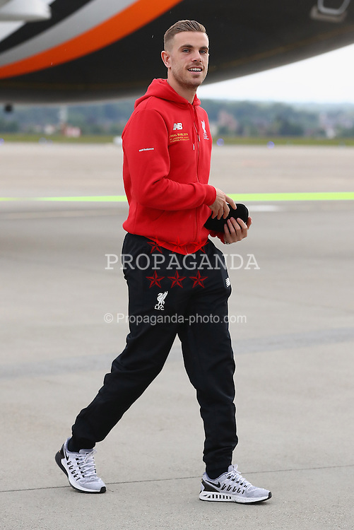 BASEL, SWITZERLAND - MAY 16: Liverpool's captain Jordan Henderson arrives at Basel airport ahead of the UEFA Europa League Final against Sevilla. (Photo by UEFA/Pool)
