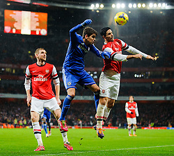 Chelsea Midfielder Oscar (BRA) and Chelsea Midfielder Frank Lampard (ENG) compete in the air during the second half of the match - Photo mandatory by-line: Rogan Thomson/JMP - Tel: Mobile: 07966 386802 - 23/12/2013 - SPORT - FOOTBALL - Emirates Stadium - Arsenal v Chelsea - Barclays Premier League.