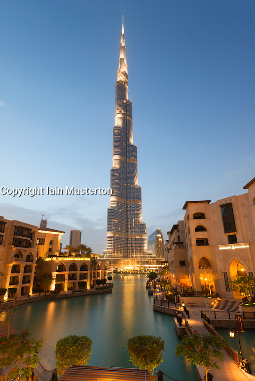 Evening view of Burj Khalifa skyscraper from Souk Al Bahar tourist district in Dubai United Arab Emirates