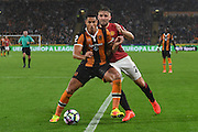 Hull City midfielder Jake Livermore (14) and Manchester United player Luke Shaw (23) during the Premier League match between Hull City and Manchester United at the KCOM Stadium, Kingston upon Hull, England on 27 August 2016. Photo by Ian Lyall.