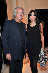 FLAVIO BRIATORE and his wife Elisabetta Gregoraci at a dinner in honour of Dennis Basso in celebration of his new boutique in Harrods held at Claridge's, Brook Street, London on 15th October 2009.
