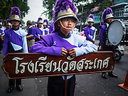 18 NOVEMBER 2015 - BANGKOK, THAILAND:  Thai high school students in a marching band at the start of the temple's annual fair. Wat Saket is on a man-made hill in the historic section of Bangkok. The temple has golden spire that is 260 feet high which was the highest point in Bangkok for more than 100 years. The temple construction began in the 1800s in the reign of King Rama III and was completed in the reign of King Rama IV. The annual temple fair is held on the 12th lunar month, for nine days around the November full moon. During the fair a red cloth (reminiscent of a monk's robe) is placed around the Golden Mount while the temple grounds hosts Thai traditional theatre, food stalls and traditional shows.     PHOTO BY JACK KURTZ