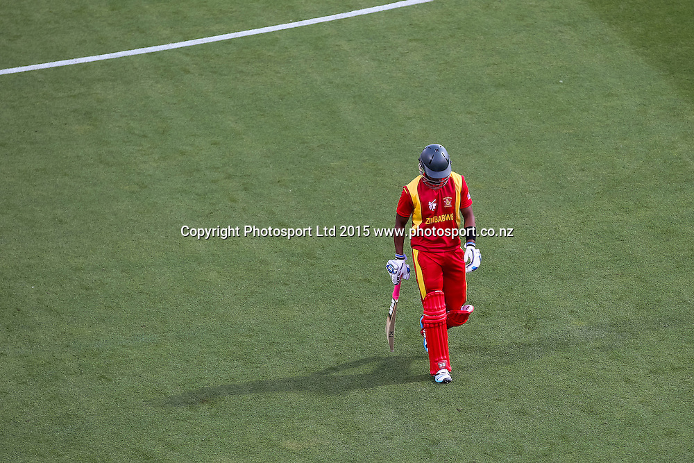 Zimbabwe's Chamu Chibhabha leaves the field after his dismissal in the ICC Cricket World Cup match - South Africa v Zimbabwe at Seddon Park, Hamilton, New Zealand on Sunday 15 February 2015.  Photo:  Bruce Lim / www.photosport.co.nz