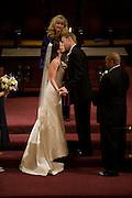 A bride and groom kiss during their wedding in Westminster Presbyterian Church in Sacramento, California.